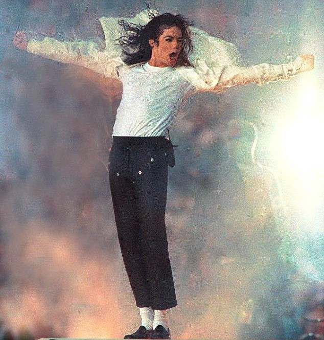 "January 1993, Pasadina, California, USA: Michael Jackson performs at the Rose Bowl. On Monday, November 24, 2003, Michael Jackson publicly launched a new website dedicated to countering the molestation charges currently being levelled against him. The website, www.MJnews.us, is intended to be Jackson's ""official source of communication,"" with Jackson writing that any statements purported to be about or from him that are not on the Web site are not credible. Last Thursday, Santa Barabara police booked Jackson on suspicion of child molestation; he was released on $3 million bond. The victim is reported to be a thirteen-year-old boy; it is widely reported that the boy is a cancer victim who appeared in the Martin Bashir documentary of Jackson that made waves when it aired early this year. Jackson has insisted that he is innocent of the current charges. However, he is no stranger to child molestation accusations; a 1993 scandal never amounted to charges because Jackson settled with his accuser in a multi-million dollar settlement out of court. Jackson is scheduled to be arraigned on January 9 in Santa Barabara Superior Court. Right now, the star is keeping a low level, while friends, family and fans have been rallying around the world to ponder the credibilty of the charges, hold vigils and wonder about the elusive star and his possibly sordid past.. Credit: Dan Cappellazzo / Polaris / eyevine For further information please contact eyevine. tel: 020 8709 8709 email: info@eyevine.com www.eyevine.com HI-RES AVAILABLE ON REQUEST"